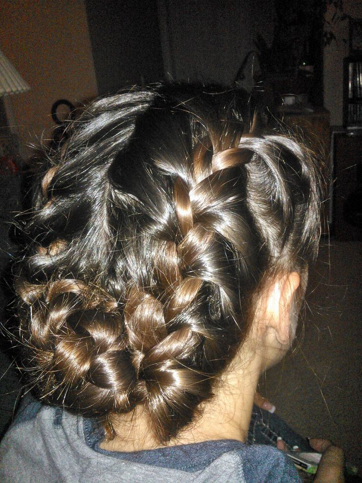 Two French braids ending in a braided bun (either with both or joining the two braids and then making the bun out of the -now- single braid)