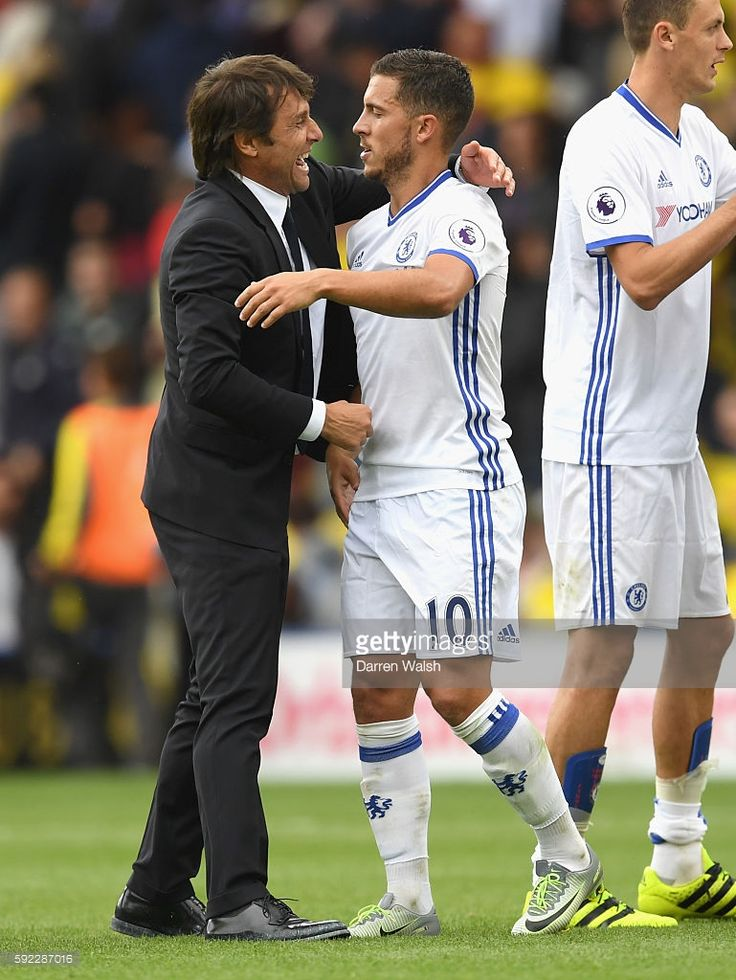 Antonio Conte, Manager of Chelsea and Eden Hazard of Chelsea hug after the game during the Premier League match between Watford and Chelsea at Vicarage Road on August 20, 2016 in Watford, England.