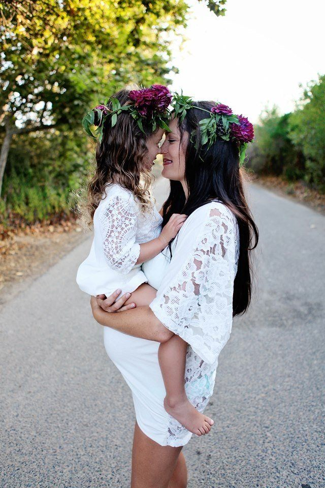 Mommy, daughter, and baby bump with flower headpieces and matching dresses!