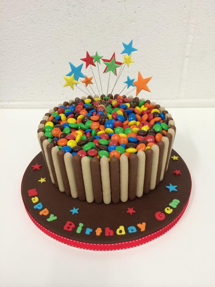 Scrummy M  M's and chocolate fingers birthday cake.