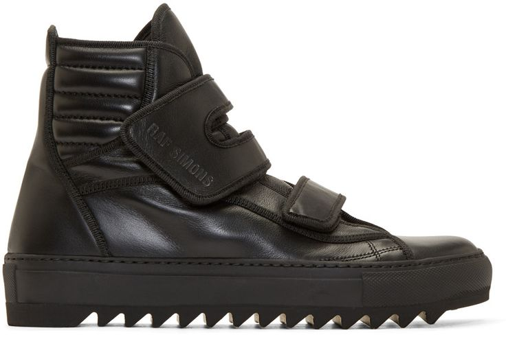 Buffed leather high-top sneakers in black. Tonal ribbed textile trim throughout. Round toe. Velcro strap closures featuring embossed logo at vamp. Pull-tab at ribbed heel collar. Vibram brand rubber sole. Tonal stitching.