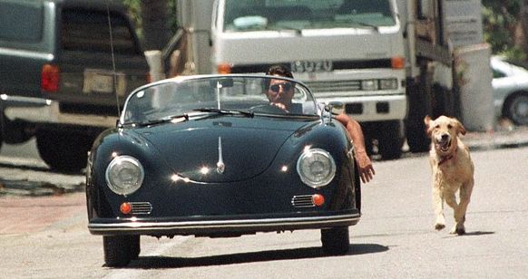 Dustin Hofman walking his dog in a Porsche Speedster...