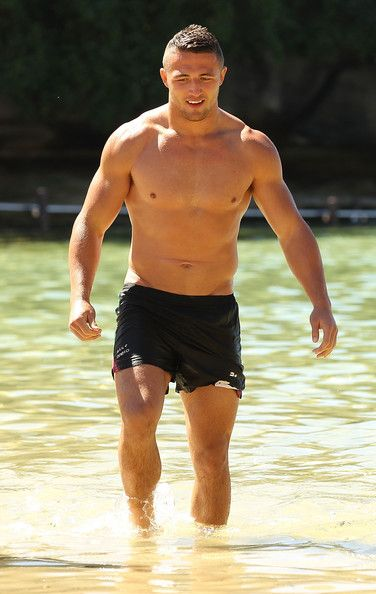 Sam Burgess walks from the ocean during a South Sydney Rabbitohs NRL recovery session at Clovelly Beach on September 23, 2013 in Sydney, Aus...