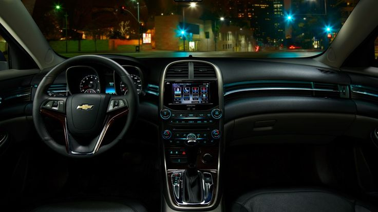 Interior view of a 2013 Chevy Malibu LTZ with ambient lighting and Chevrolet MyLink.