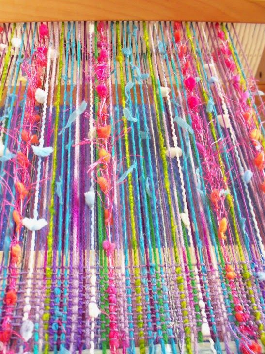 Annar: weaving-Put the fantasy yarns in the slots and smooth, thinner weight yarns in the holes.