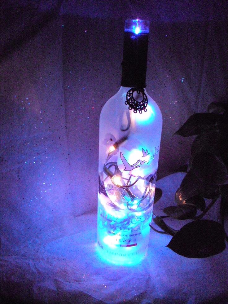Lighted gray goose bottle.