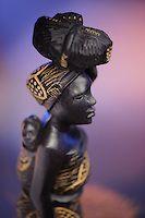 A woman with her baby on her back (Angolan handicraft, Luanda, Angola) | Uma mulher com a sua criança nas costas (artesanato angolano, Luanda, Angola).