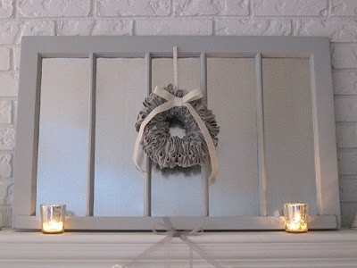 Mantle decor made with galvanized sheet metal and an old window. Great focal point.
