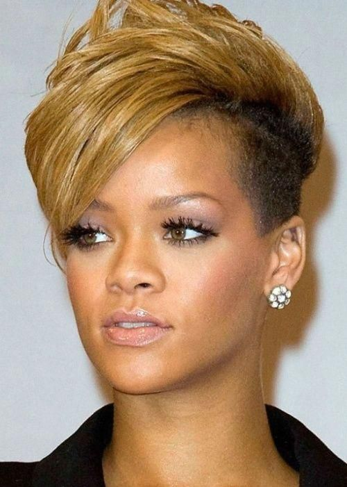 Rihanna African American Hairstyle: Blonde mohawk Rihanna mixes it up and rocks an edgy, blonde mohawk with a side-swept fringe. Description from pint...
