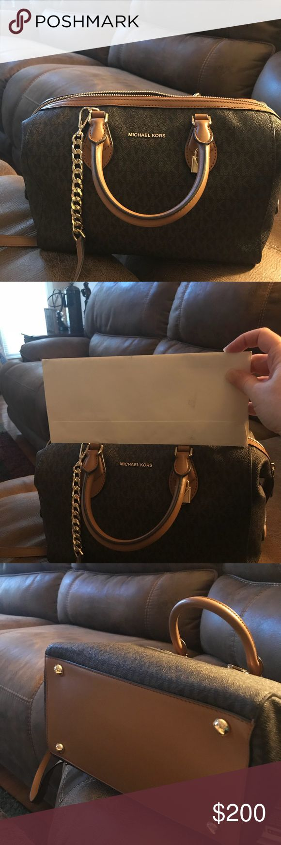 Michael Kors Brown Monogram Satchel/crossbody Purchased in January 2018.  Carried about a month realIzed it's too big for me. Retail price is $348.00. I paid $208.80 plus tax   Not sure of the measurements but in one of the pictures I'm holding a regular sized envelope and it easily fills inside the bag with room to spare.  From my observance there are no stains rips or holes in the interior of the purse it's in like new condition    Strap is detachable.  Tag is still attached Michael Kors…