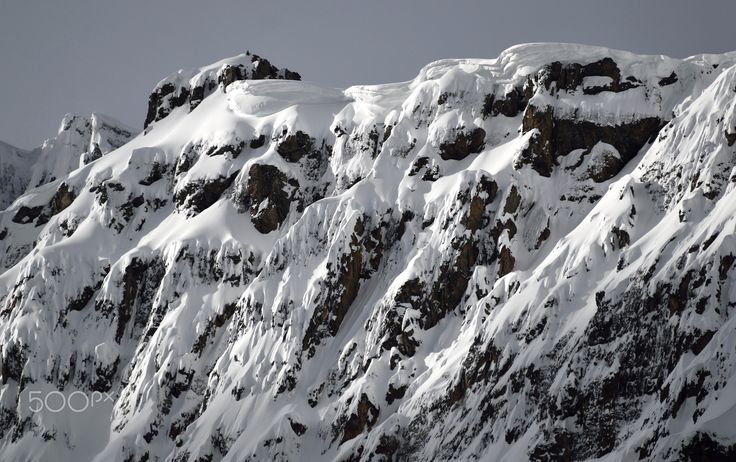 Snow Peaked Summit - Snow covering on the tops of a mountain summit in the winter. extreme