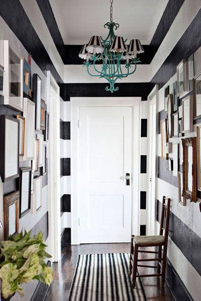 Image of a hallway painted in bold black and white stripes