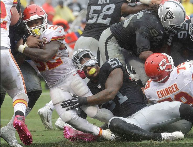 Chiefs vs. Raiders:    October 16, 2016   -  26-10, Chiefs  -    Kansas City Chiefs running back Spencer Ware (32) runs for a touchdown past Oakland Raiders outside linebacker Bruce Irvin (51) during the first half of an NFL football game in Oakland, Calif., Sunday, Oct. 16, 2016.