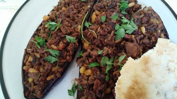 Middle eastern stuffed aubergines with lamb mince and pine nuts.