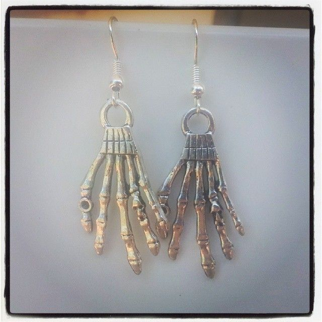 Silver Skull Hands Earrings $5 Aust. From Rags To Bags on FaceBook.