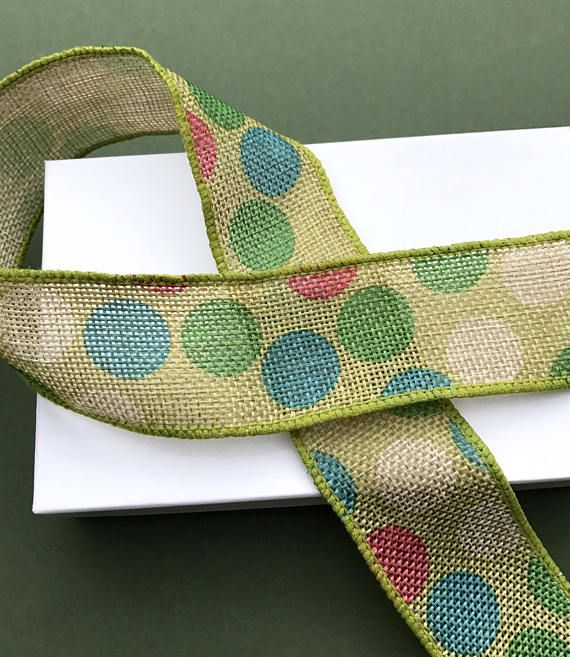 Welcome to Just Create Craft Supplies!!   Lovely wide, wired burlap trim in green with multi-coloured dot print. Perfect for bows, floral bouquets and decorations. Very versatile trim.   Item details are as follows:  Theme: Multi-coloured Dotty Print Burlap  Brand: Berties Bows