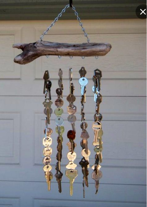 Get old keys from a locksmith (they throw them away or recycle them). Tie keys to fishing line and then to hooks in a piece of driftwood (or a branch). Hang and enjoy!