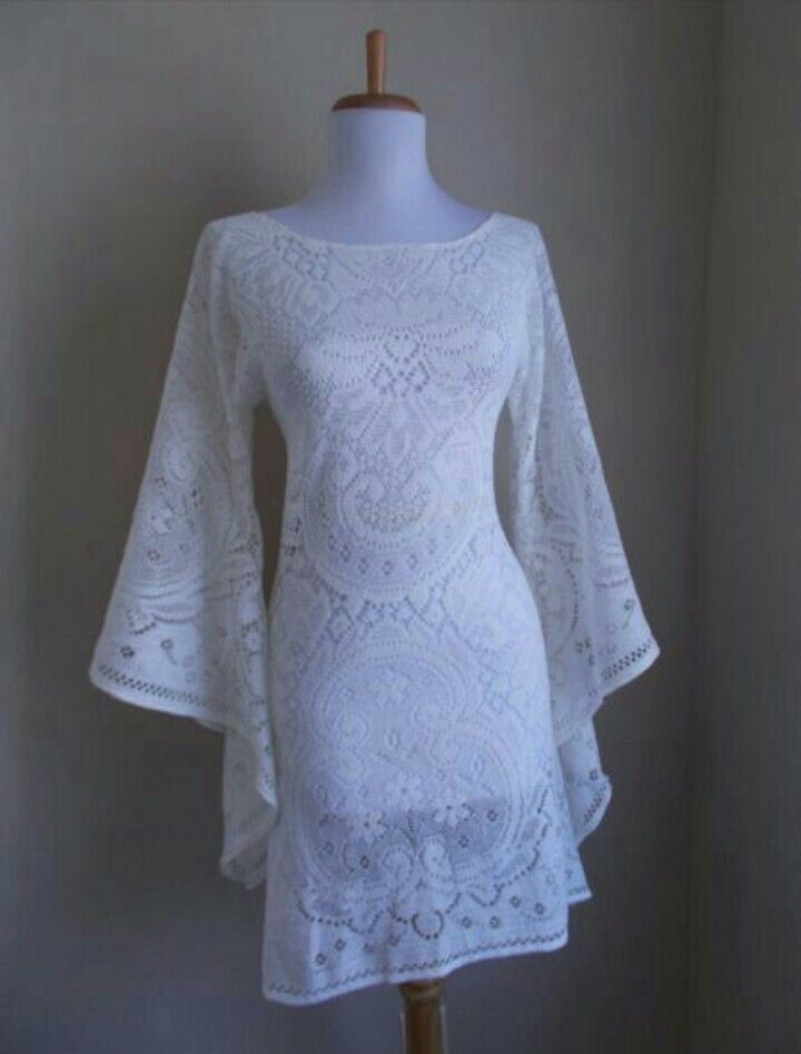 Not really a wedding dress, but i live the lace look with the bell sleeves