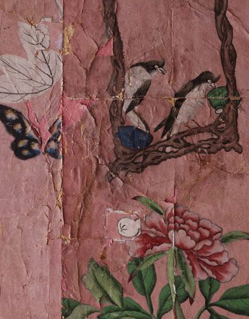 """Beauty in the Old - A close-up of the bedroom's hand-painted 18th-century Chinese wallpaper, in all its tattered, patched, beguiling beauty. """"I papered the bedroom wall in the spirit of a collage, making the most of a beautiful old thing,"""" says Kaihoi.  - I think this could be done without the antique wallpaper, with handmade paper or something like that. Pretty accent wall idea for a small space."""