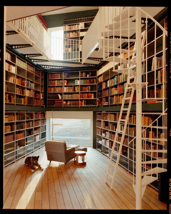 Private library designed by architecture firm Ilai, photography by Lukas Wassmann.