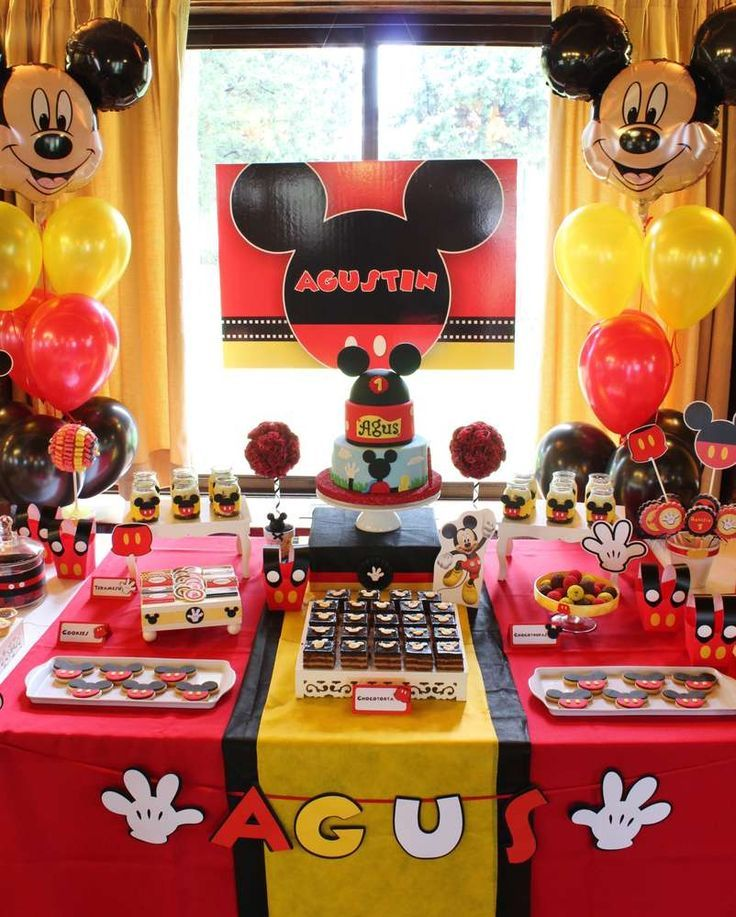 Dessert table at a Mickey Mouse baptism party! See more party ideas at http://CatchMyParty.com!