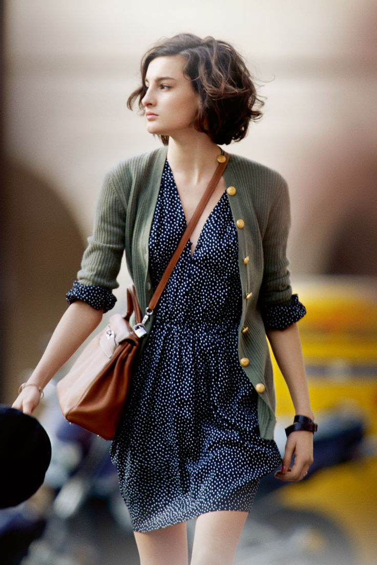 Like the dots on the dress and the interesting buttons on the cardigan. Good colors.