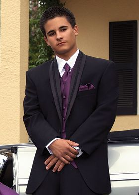 After Six El Rey black tuxedo with purple vest. The El Rey Tuxedo, made of super 100?s woolis a perfect choice for special occasions such as weddings or quinceanera?s. The two-button El Rey tuxedo jacket has a satin shawl lapel with braid for a stand out look. #prom, #dance, #blacktuxedo, #tuxedojunction, #lasvegastux, #weddingtuxedo, #promtuxedo, #formal, #tuxedo