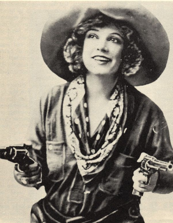 "Mary Louise Guinan—better known as ""Texas"" Guinan (1884-1933). Getting her big start in Vaudeville in 1909, Mary drifted into film by 1917.  First cast as a vamp, she quickly found her niche as a Western heroine and movie star, cranking out westerns for 6 years.  In 1922, tiring of the movies, she made her way to New York where she became an icon of the night club scene, intimate with movie stars, partnering with gangsters, she became so notorious as to be barred from entering England or…"