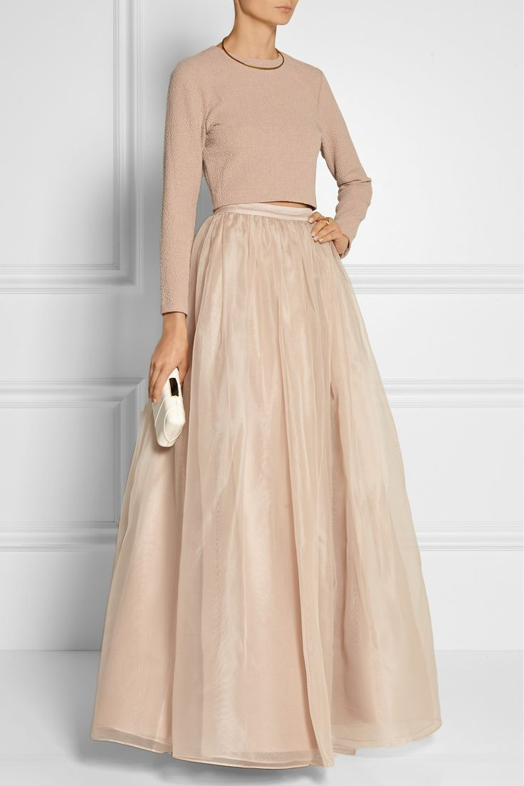 Alice + Olivia's voluminous 'Abella' maxi skirt is crafted from double layers of wispy silk-organza and lined in satin for a added fluidity. The waistband sits at the slimmest part of your waist. Style it for evening with a cropped sweater and clutch.