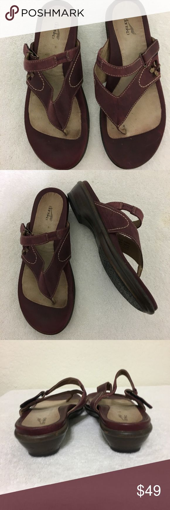 "Auth Dansko Leather Thong Sandals 6.5 Burgundy Authentic Dansko leather thong sandals, Size 6.5 for sale.  Burgundy/Merlot color with 1"" heels.  Adjustable strap utilizing velcro with small floral detail.  Light wear, good condition. Dansko Shoes Sandals"