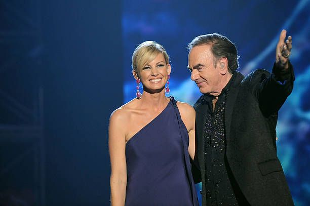 Singers Faith Hill and Neil Diamond perform at the 2009 MusiCares Person of the Year Tribute to Neil Diamond at the Los Angeles Convention Center on February 6, 2009 in Los Angeles, California.