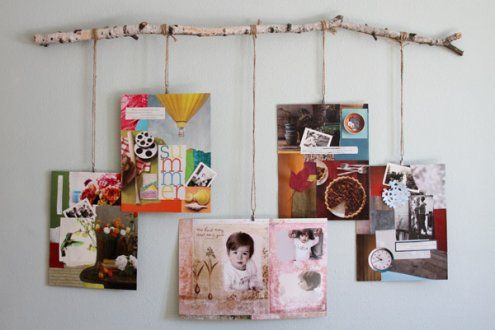 Using a tree branch to hang photos.