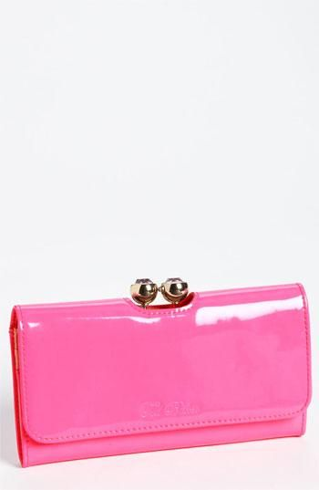 Bold, pink Ted Baker patent wallet.