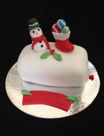 Snowman and stocking Christmas Cake by Chaos Cakes za