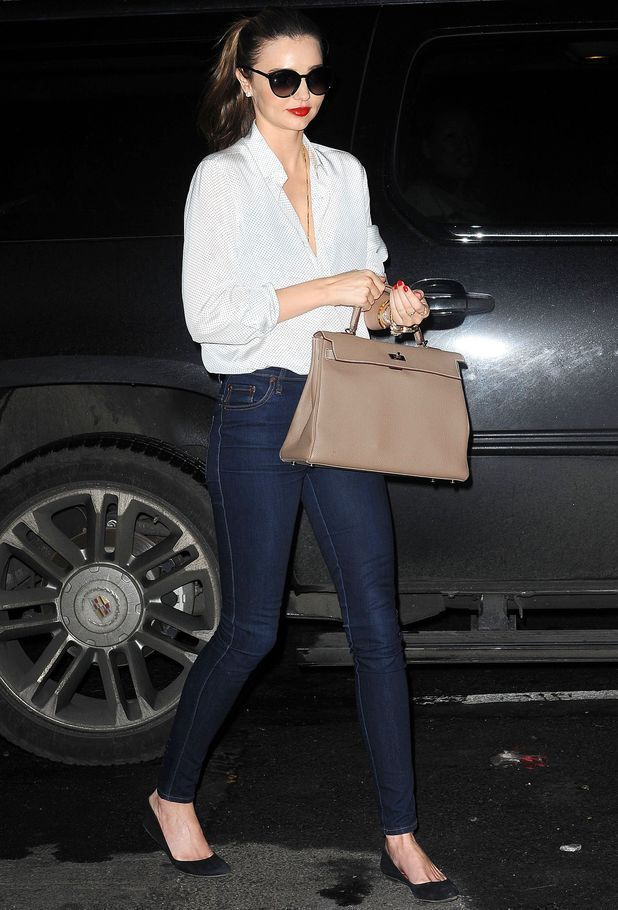 Silk blouse (ticked in to jeans), long necklace. Like the pop of lipstick and nail color.