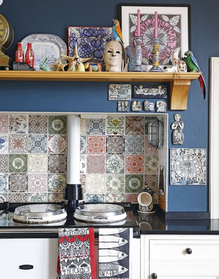 Eclectic Painted Kitchen with Patterned Tiles and Retro Furniture