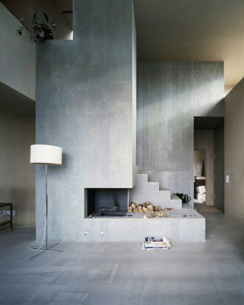 Here an architectural composition of the fireplace and staircase, House Müller Gritsch by AFGH  Do you want a #concrete effect at home? Try Archi+ Concrete the new decorative system by Novacolor. Archi+ Concrete is a #mineral plaster coat in powder for interiors, formulated in respect of the traditional Italian #heritage. #architecture #interiordesign