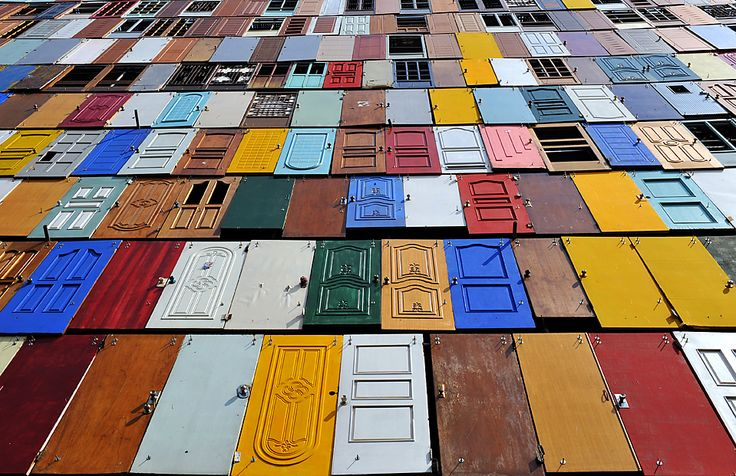 Colorful doors decorated the wall of a building being remodeled in downtown Seoul Thursday. (Kim Jae-hwan/Agence France-Presse/Getty Images)