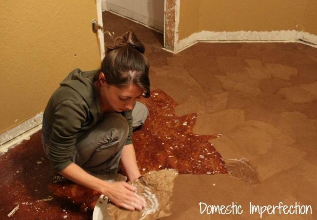 paper sack flooring over concrete.  She did a 10 x 12 room for $80 and had a lot of left over paper.