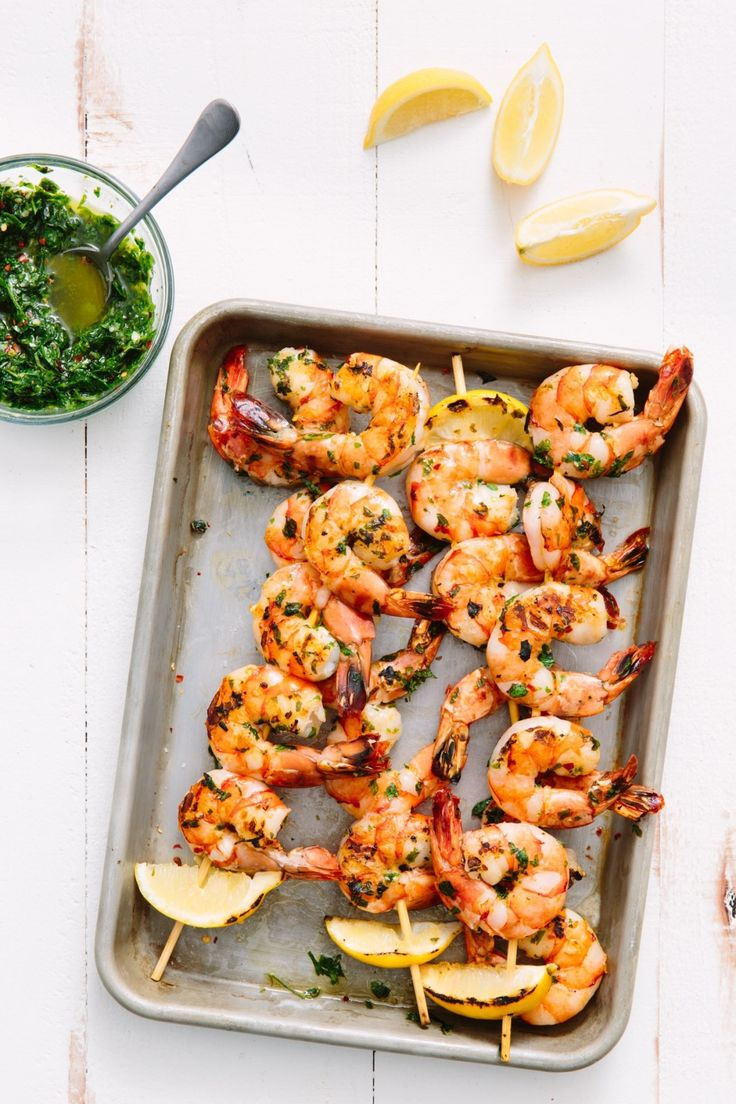 Recipe: Grilled Shrimp Skewers with Chimichurri | If you're looking for something other than chicken and burgers to grill, shrimp is the answer. When grilled with an herby, garlicky chimichurri sauce that doubles as both a marinade and a dipping sauce, shrimp skewers have enough bold flavor with only five minutes on the grill to cook. Serve them for dinner on a busy weeknight or as a fast and fancy appetizer at your next grilling party.