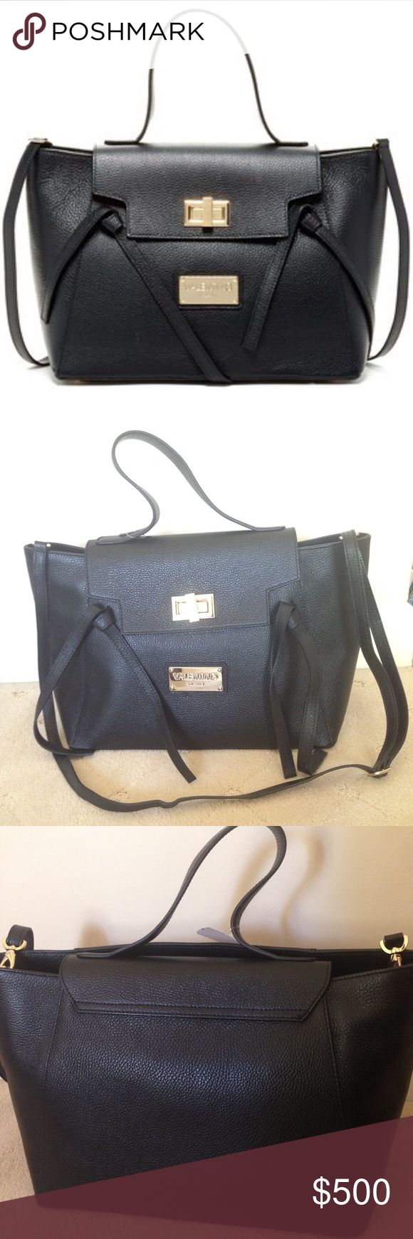"""Valentino Camilla Genuine Leather Tote! MARIO VALENTINO BAG! Comes with single top handle and detachable, adjustable shoulder strap! The foldover flap has a turn-lock closure. The exterior features metal logo accent, knotted ties, and metal feet. The interior features zip top closure, 1 zip pocket, and 2 media pockets. Measures Approx. 11"""" H x 17"""" W x 7.5"""" D with approx. 6"""" handle drop, 11-24"""" strap drop Retails for over $800 - don't miss out on the discount!! Authentic bag but doesn't come…"""