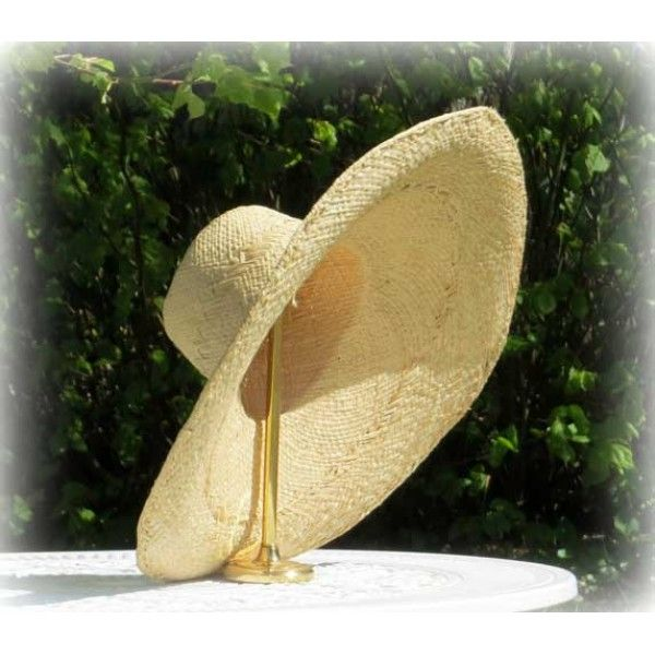 A great Fair Trade hat  handcrafted of sundried raffia palmleaves  by women in rural Africa.