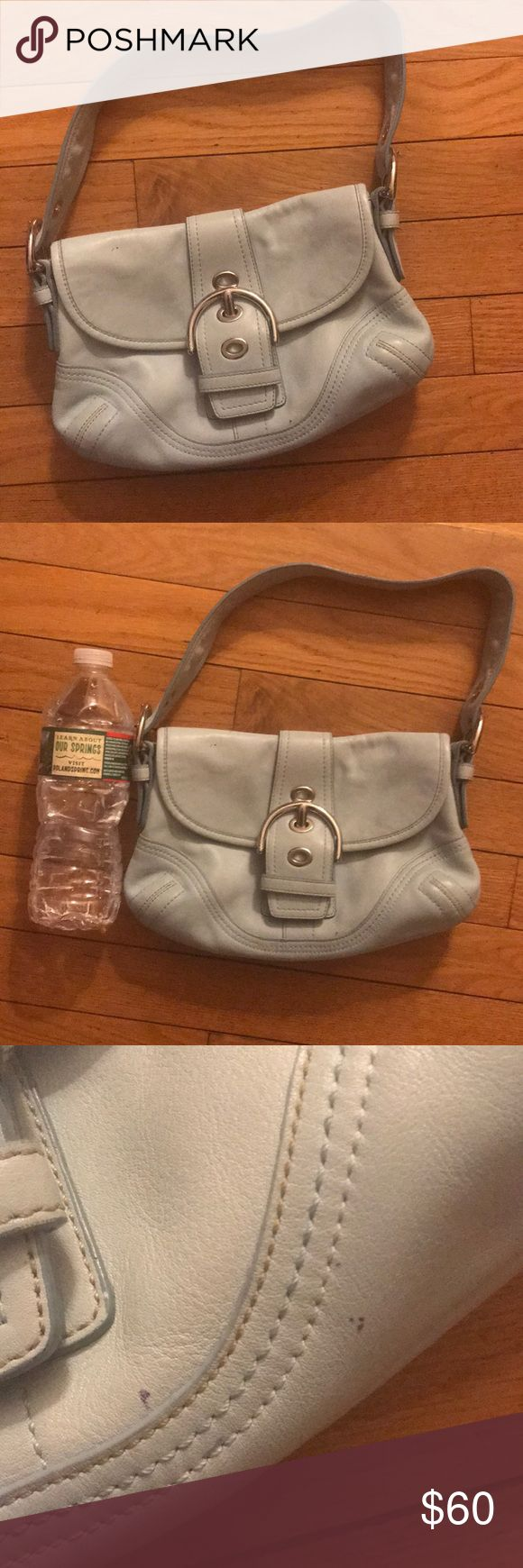 Adorable mint green Coach purse Adorable mint green coach purse! Not in perfect condition, but definitely in great condition considering it is over 10 years old. I only used it a couple of times and it has been in storage ever since. Coach Bags Mini Bags