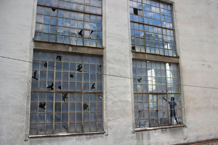 Barcelona-based artist Pejac (previously) was recently in Rijeka, Croatia where he completed a number of new artworks as part of a residency with the Museum of Modern and Contemporary Art. His most impressive new intervention appeared in the windows of an abandoned power plant where the artist utili