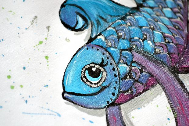 little fish painted on t-shirt