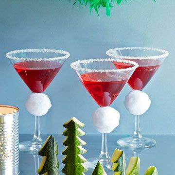 Tipsy Santa Cocktail - Thread string through a jumbo white pom-pom or cotton ball and tie it around a martini glass stem. Rub a lemon wedge around the rim, then dip rim in sugar. A red drink makes it a true Santa hat!