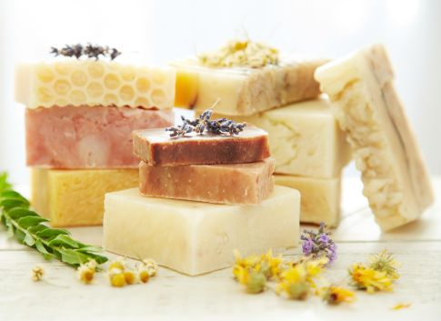 Stock Photo : Stacks homemade organic bars of soap with lavender on top