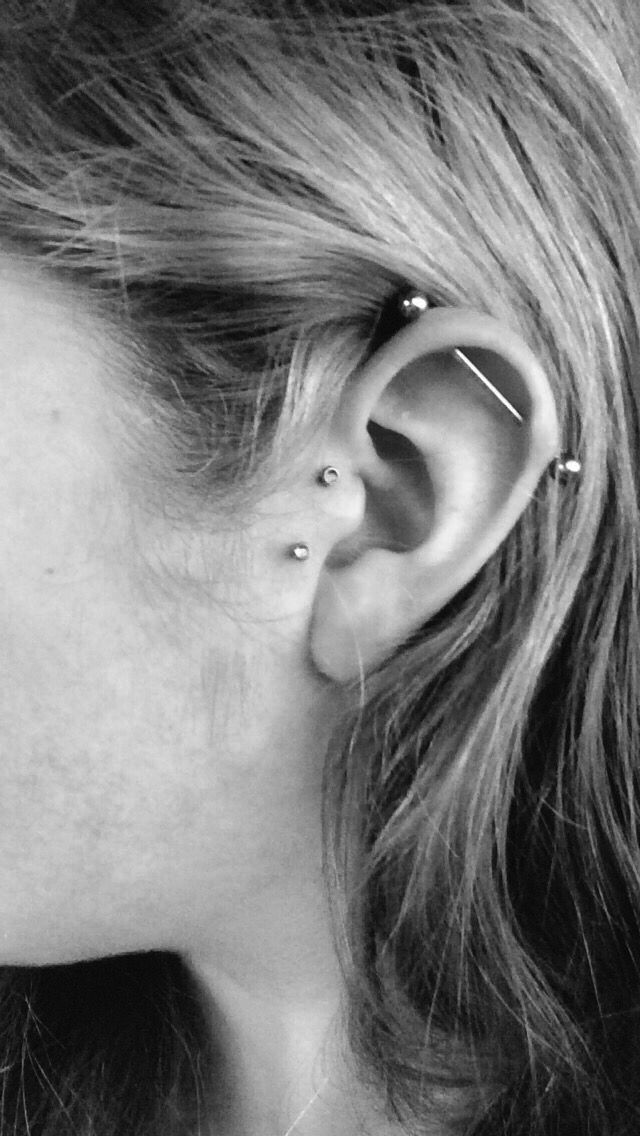 Vertical Tragus hot damn I love these ear piercings