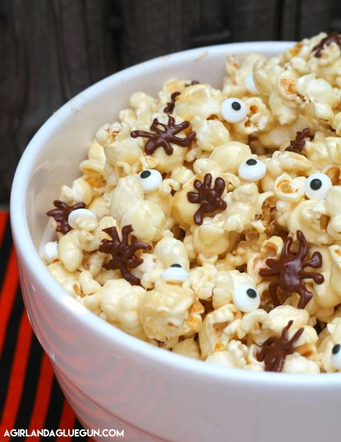 Today I have a fun Halloween snack–Sticky Caramel Marshmallow Popcorn! This is part of my girl Alli's  30 days of Halloween series!  (I love that she loves Halloween as much as I do!) This recipe is yummy–and not just for Halloween! But since it's Halloween…why not throw in some fun Spiders and eyeballs!! It's totally …
