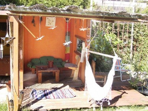 A rustic kid's play house built with flea market finds and scratch | Offbeat Families